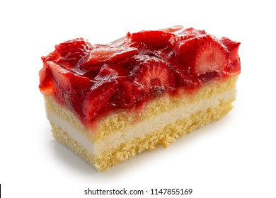Slice of sponge cake topped with strawberries and jelly isolated on white.