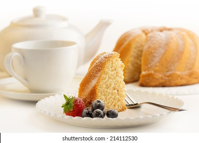 slice of sponge cake and white porcelain