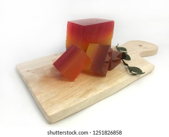 a slice stacked of rainbow jelly on wooden vintage plate
