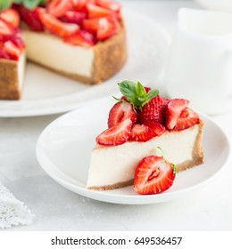 slice of strawberry cheesecake on white background, selective focus, square image
