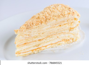 Slice of sweet classic layered cake Napoleon for background