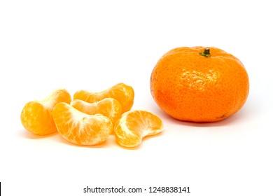 Slice tangerine mandarine orange, small mandarin, Chinese Citrus Fruit,Chinese Mandarin orange on white background. Orange fruits and peeled segment Isolated. Pile of orange segments.