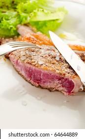 slice t-bone with salt