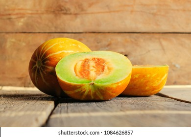 Slice of Thai melons or cantaloupe on wooden table background