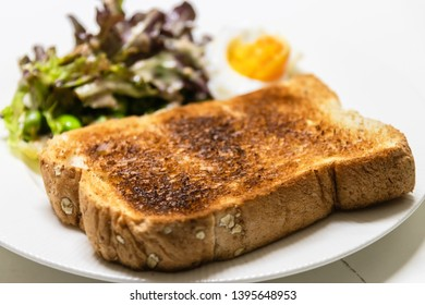 Slice toast bread with salad and boiled egg a easy breakfast.