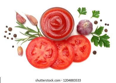 slice of tomato with parsley and glass bowl of ketchup isolated on white background. top view