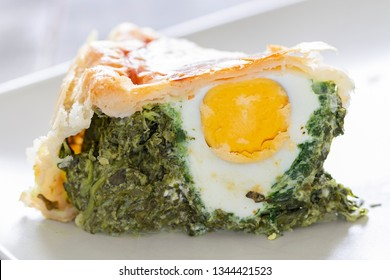 "A slice of ""Torta pasqualina"" pie close up."
