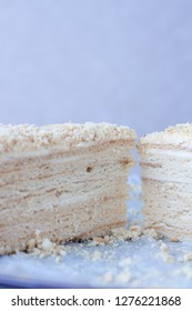 A slice of traditional Russian honey cake with mascarpone and double cream with fork