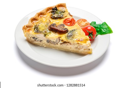 Slice of traditonal homemade spinach chicken quiche tart or pie on plate