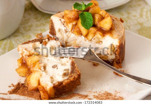Slice of vanilla cheesecake decorated with apple topping
