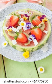 Slice of water melon with fresh fruits served as a pizza