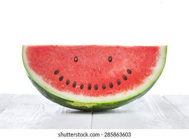 Slice of watermelon with seeds that make a smiling face
