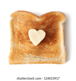 Slice of white bread toast on a white background. A butter pat in the shape of a love heart has been placed in the centre of the toast.