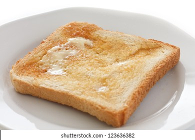 Slice of white buttered toast on a plate