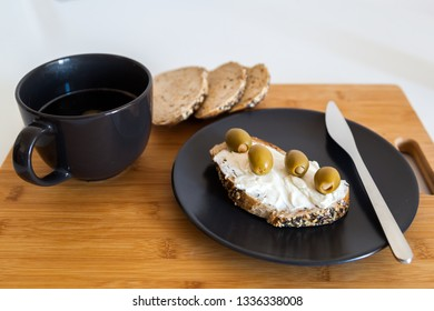 Slice of Whole Grain Bread with cheese and olives