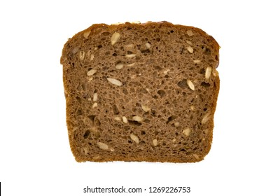 Slice of wholemeal dark bread isolated on a white background in close-up (high details)