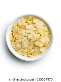 Sliced almonds in bowl isolated on white background.