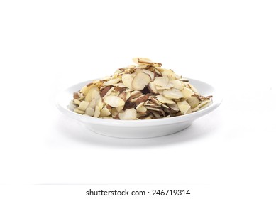 Sliced almonds in a white plate on a white background