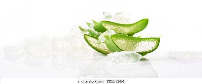 Sliced aloe vera leaf on a white background