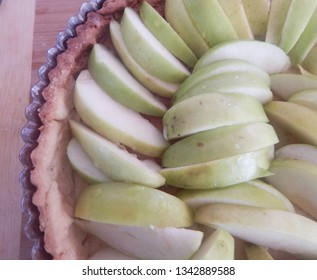 A sliced apple tart in close up before being baked.