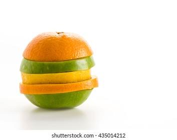 sliced apples and orange fruit on white backgrund