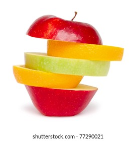 sliced apples and oranges on white with shadow