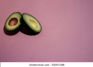 sliced Avocado isolated on a pink background