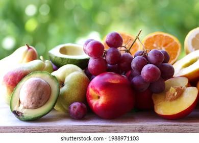 sliced avocado, peach, grapes and citric fruits