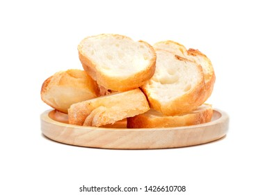 Sliced baguette bread on a wooden plate, Baguette bread, French bread, Organic baguette francese on white background