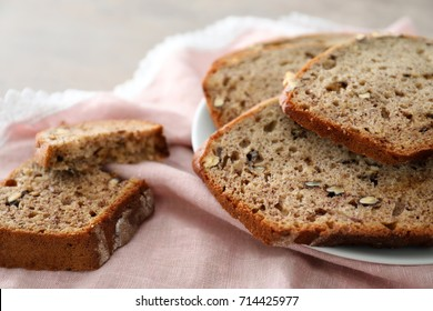 Sliced banana bread with nuts on plate