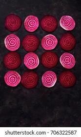 Sliced beetroot arrange in pattern on dark  background. Top view with copy space
