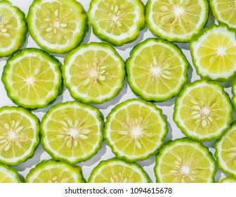 Sliced bergamot on white background
