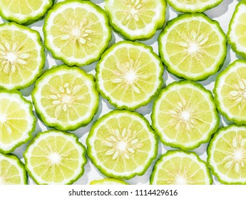 Sliced bergamot on white background
