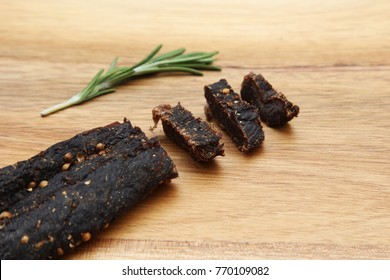 Sliced biltong (jerked meat) on a wooden board. This is a very popular snack in South Africa.