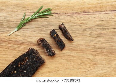 Sliced biltong (protein snack) on a wooden board. This is a very popular snack in South Africa.