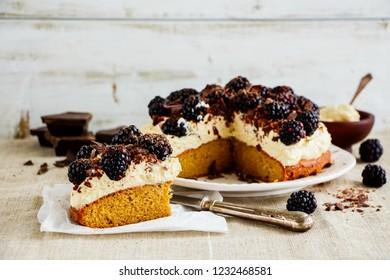 Sliced blackberry cake with mascarpone cream and chocolate