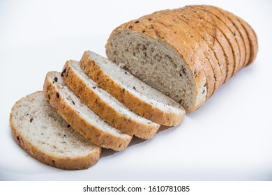 sliced cereal bread close-up on a light background