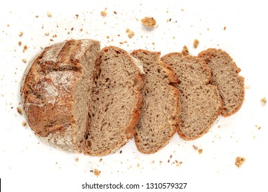 Sliced bread isolated on  white background. Crumbs and fresh Bread slices close up. Bakery, food concept. Top view