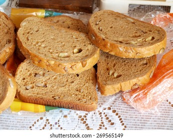 Sliced bread with nuts and seeds close up