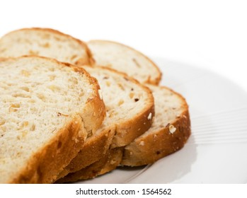 Sliced bread on plate.  Isolated on white.