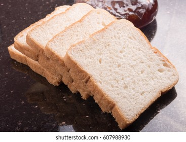 sliced bread on wooden background