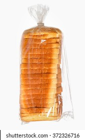 Sliced bread in a plastic bag on white surface.