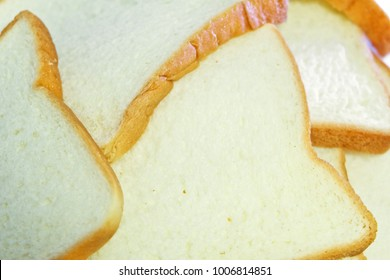 Sliced bread.Multiple sheets bread.pile Bread On a white background. It is made from wheat flour mixed with water and yeast or baking powder. Can be used as a background image for food and cakes.