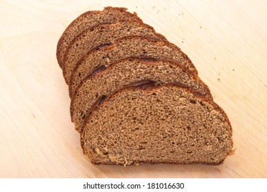 sliced brown bread on table