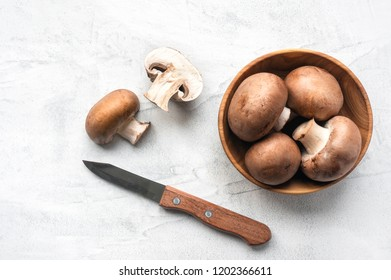 Sliced Brown Mushrooms. Top view. Concrete background.