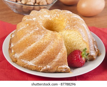 sliced cake with a strawberry and knife