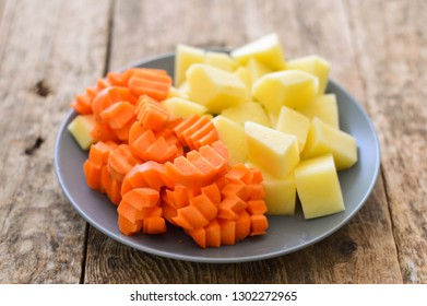 Sliced potatoes and carrots