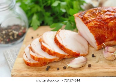 Sliced chicken roll baked with spices and garlic