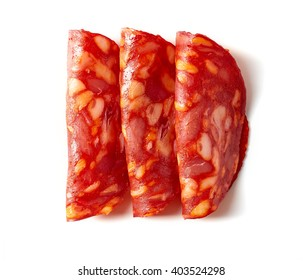 Sliced chorizo sausage isolated on white background, top view