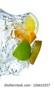 sliced citrus fruit with kiwi splashing isolated on white background